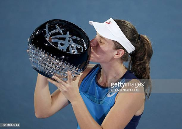Johanna Konta of Britain kisses the trophy after beating Agnieszka Radwanska of Poland in the women's singles final match at the Sydney International...