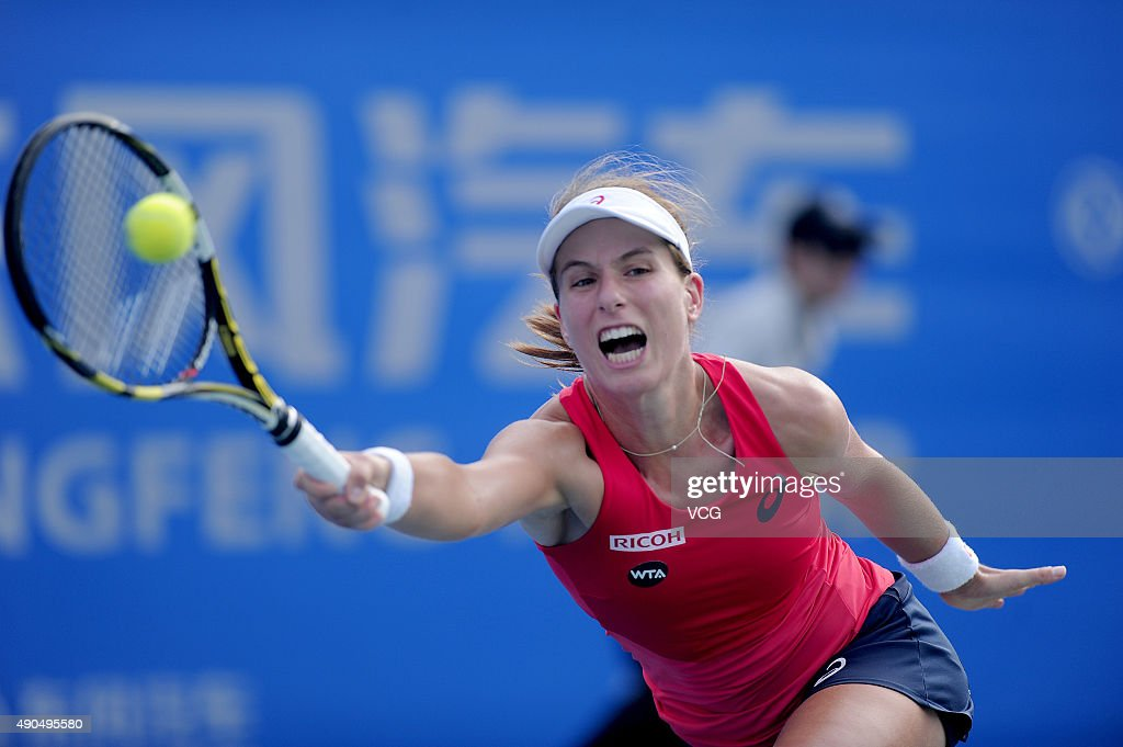 Johanna Konta of Britain returns a shot against Victoria Azarenka of Belarus during day three of the 2015 Wuhan Open at Optics Vally International Tennis Center on September 29, 2015 in Wuhan, Hubei Province of China.