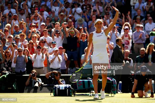 Johanna Konta of Great Britain acknowledges the crowd as she celebrates victory after the Ladies Singles second round match against Donna Vekic of...