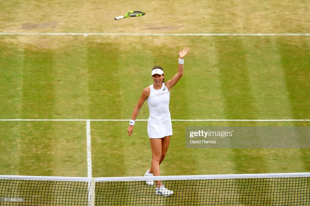 Johanna Konta of Great Britain acknowledges the crowd as she celebrates victory after the Ladies Singles fourth round match against Caroline Garcia of France on day seven of the Wimbledon Lawn Tennis Championships at the All England Lawn Tennis and Croquet Club on July 10, 2017 in London, England.