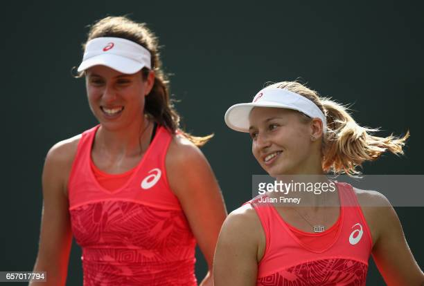 Johanna Konta of Great Britain and Daria Gavrilova of Australia in their doubles match against Svetlana Kuznetsova of Russia and Kristina Mladenovic...