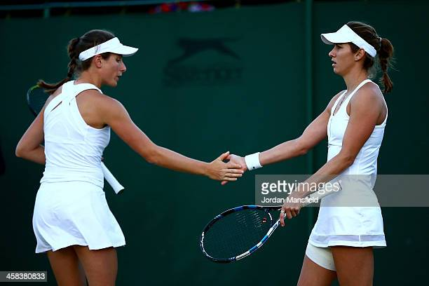 Johanna Konta of Great Britain and Maria Sanchez of The United States in conversation during the Ladies doubles first round match against Andrea...
