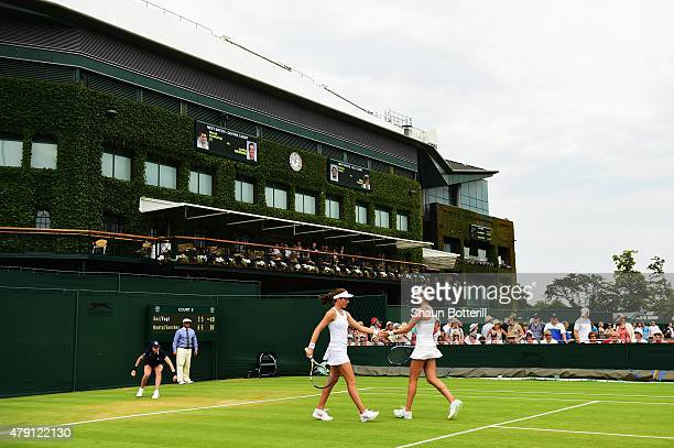 Johanna Konta of Great Britain and Marie Sanchez of the United States celebrate a point in their Ladies Doubles First Round match against Misaki Doi...