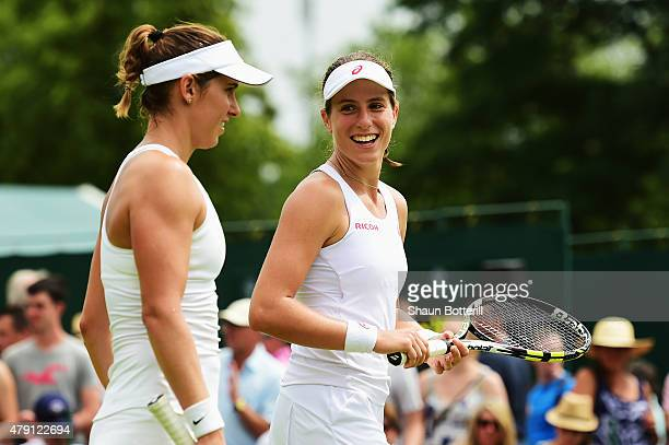 Johanna Konta of Great Britain and Marie Sanchez of the United States talk tactics in their Ladies Doubles First Round match against Misaki Doi of...