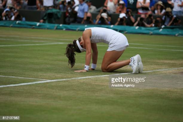Johanna Konta of Great Britain celebrates after beating Caroline Garcia of France on day seven of the 2017 Wimbledon Championships at the All England...