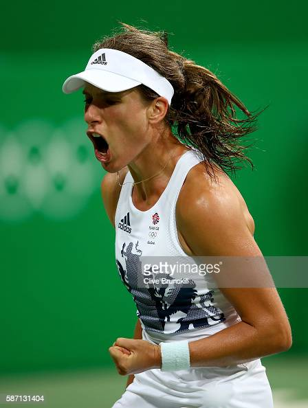 Johanna Konta of Great Britain celebrates after victory over Stephanie Vogt of Liechtenstein in their singles match on Day 2 of the Rio 2016 Olympic...