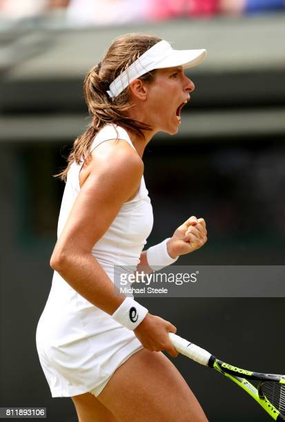 Johanna Konta of Great Britain celebrates as she wins the first set during the Ladies Singles fourth round match against Caroline Garcia of France on...