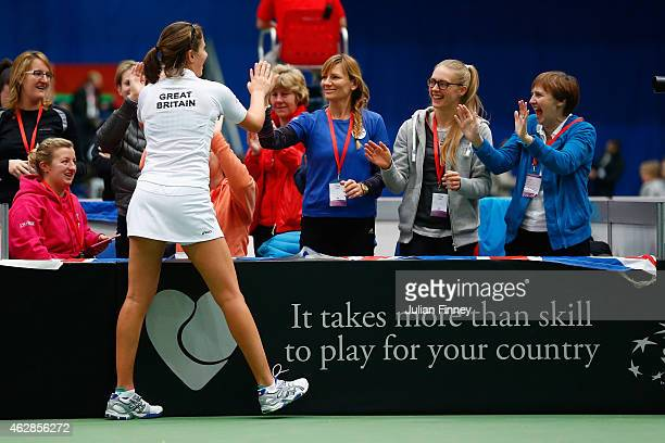 Johanna Konta of Great Britain celebrates defeating Lesia Tsurenko of Ukraine during day three of the Fed Cup/Africa Group One tennis at Syma Event...