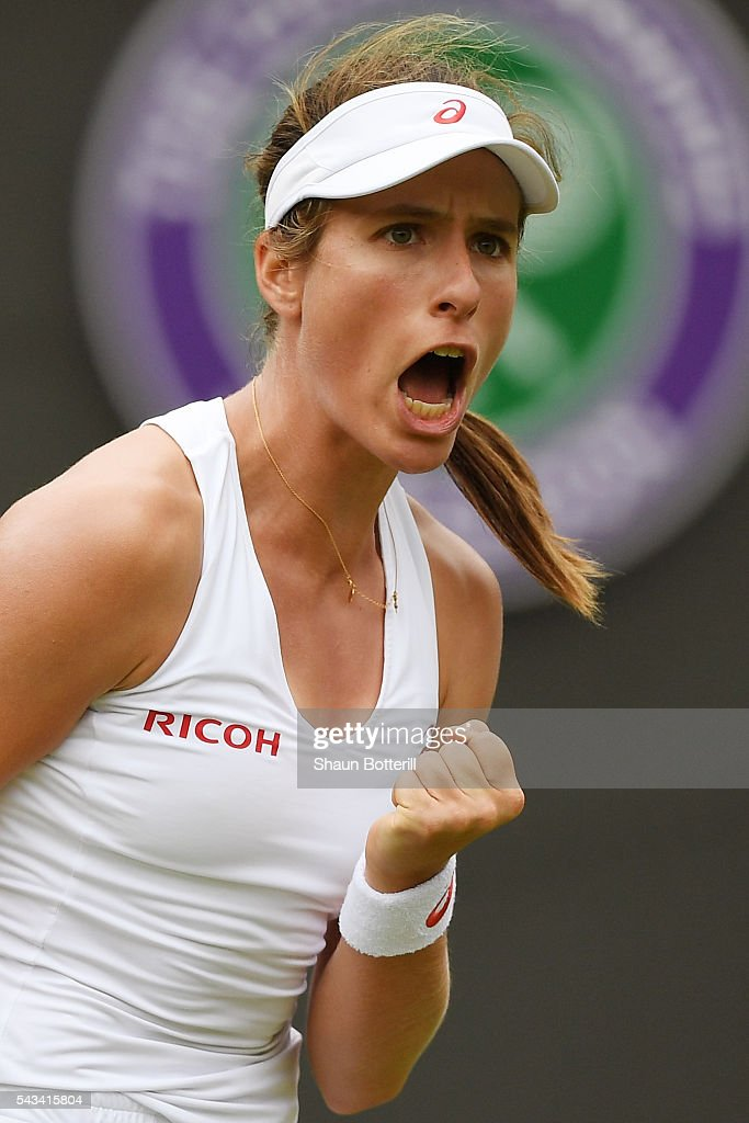 Johanna Konta of Great Britain celebrates during the Ladies Singles first round match against Monica Puig of Puerto Rico on day two of the Wimbledon...