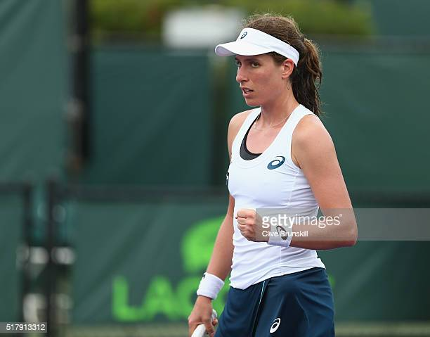 Johanna Konta of Great Britain celebrates match point against Monica Niculescu of Romania in their fourth round match during the Miami Open Presented...