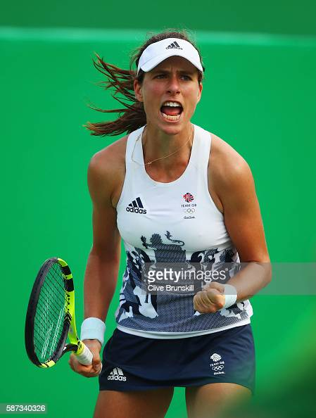 Johanna Konta of Great Britain celebrates match point and victory during the Women's Singles second round match against Caroline Garcia of France on...