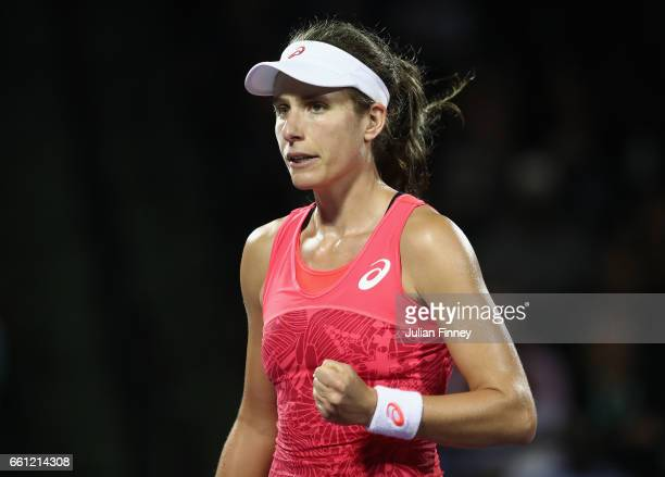 Johanna Konta of Great Britain celebrates winning a game against Venus Williams of USA in the semi finals at Crandon Park Tennis Center on March 30...