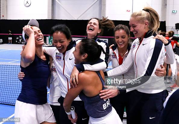 Johanna Konta of Great Britain celebrates with captain Anne Keothavong Jocelyn Rae Heather Watson and Laura Robson after the Fed Cup Europe/Africa...