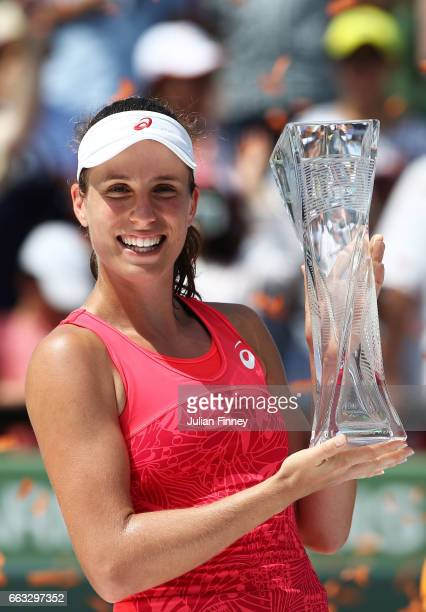 Johanna Konta of Great Britain celebrates with the Butch Buchholz trophy after winning the women's singles final match against Caroline Wozniacki of...