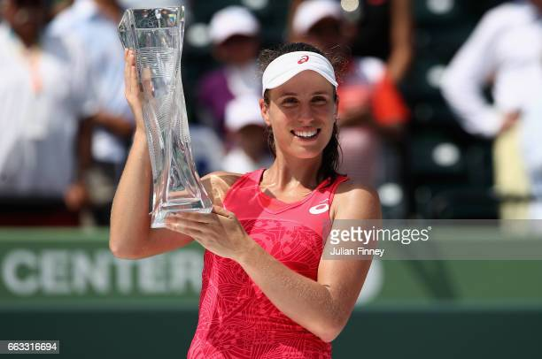 Johanna Konta of Great Britain celebrates with the trophy after defeating Caroline Wozniacki of Denmark in the final at Crandon Park Tennis Center on...