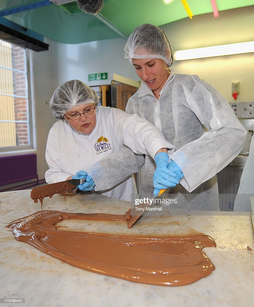Johanna Konta of Great Britain has a go at making Cadbury's Chocolate under the supervision of Cadbury's Chocolatier Gail Deeley during the behind the scenes VIP Experience helping the chocolatiers at Cadbury World during The AEGON Classic Tennis Tournament at Edgbaston Priory Club on June 10, 2013 in Birmingham, England.