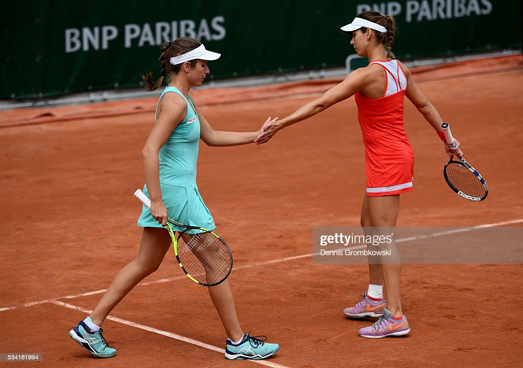 <a gi-track='captionPersonalityLinkClicked' href=/galleries/search?phrase=Johanna+Konta&family=editorial&specificpeople=4482643 ng-click='$event.stopPropagation()'>Johanna Konta</a> of Great Britain (L) high fives with Maria Sanchez of the United States during the Women's Double first round match against Raquel Atawo and Abigail Spears of the United States at Roland Garros on May 25, 2016 in Paris, France.