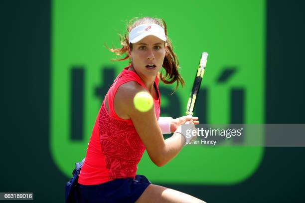 Johanna Konta of Great Britain hits a backhand during the women's singles final match against Caroline Wozniacki of Denmark on day thirteen of the...