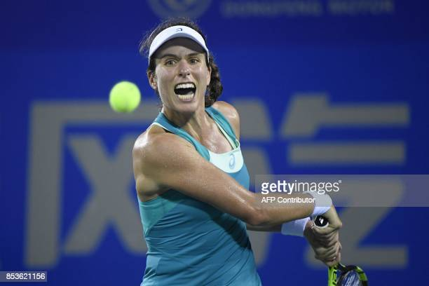 Johanna Konta of Great Britain hits a return against Ashleigh Barty of Australia during their first round women's match at the WTA Wuhan Open tennis...