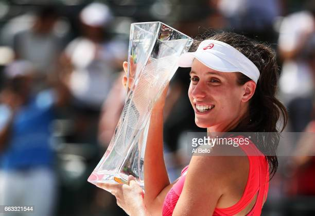 Johanna Konta of Great Britain holds the winner's trophy after defeating Caroline Wozniacki of Denmark after the Women's Final on Day 13 of the Miami...