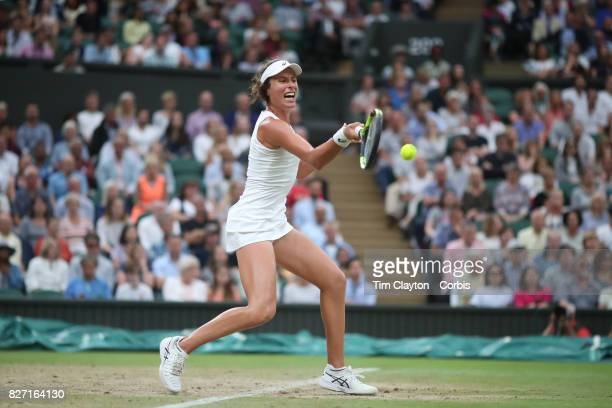 Johanna Konta of Great Britain in action against Simona Halep of Romania in the Ladies' Singles Quarter Final match on Center Court during the...