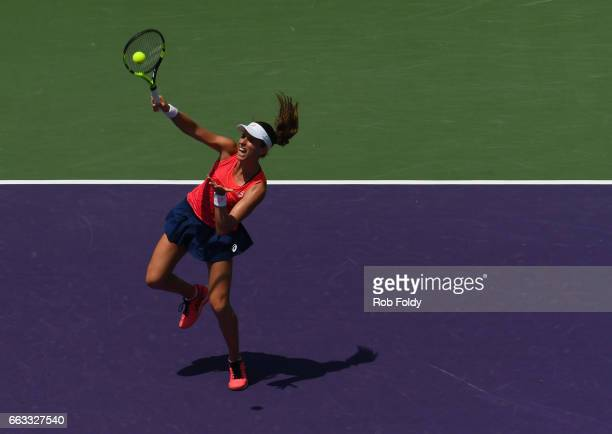 Johanna Konta of Great Britain in action in the final match against Caroline Wozniacki of Denmark on day 13 of the Miami Open at the Crandon Park...