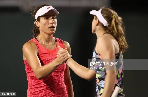 Johanna Konta of Great Britain is congratulated by Aliaksandra Sasnovich of Belarus after Konta's 3 set win at Crandon Park Tennis Center on March 24...
