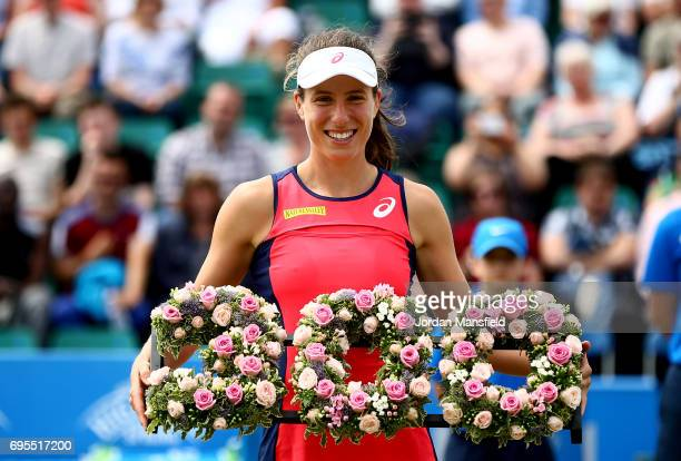 Johanna Konta of Great Britain is presented with a wreath to commemorate her 300th singles career win after her victory over Tara Moore of Great...