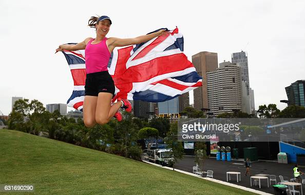 Johanna Konta of Great Britain leaps with the Union Jack in front of the Melbourne skyline prior to her first practice session ahead of the 2017...