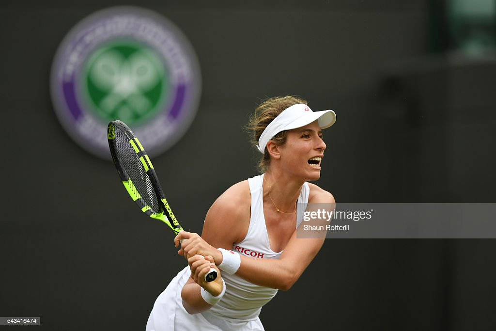 <a gi-track='captionPersonalityLinkClicked' href=/galleries/search?phrase=Johanna+Konta&family=editorial&specificpeople=4482643 ng-click='$event.stopPropagation()'>Johanna Konta</a> of Great Britain looks on during the Ladies Singles first round match against Monica Puig of Puerto Rico on day two of the Wimbledon Lawn Tennis Championships at the All England Lawn Tennis and Croquet Club on June 28, 2016 in London, England.
