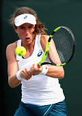 Johanna Konta of Great Britain plays a backhand against Elena Vesnina of Russia in their third round match during the Miami Open Presented by Itau at...