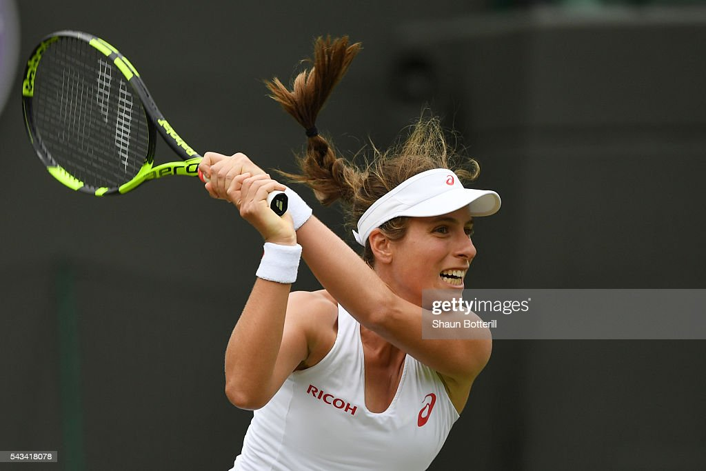 <a gi-track='captionPersonalityLinkClicked' href=/galleries/search?phrase=Johanna+Konta&family=editorial&specificpeople=4482643 ng-click='$event.stopPropagation()'>Johanna Konta</a> of Great Britain plays a backhand during the Ladies Singles first round match against Monica Puig of Puerto Rico on day two of the Wimbledon Lawn Tennis Championships at the All England Lawn Tennis and Croquet Club on June 28, 2016 in London, England.
