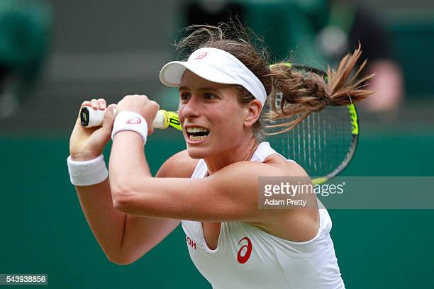 Johanna Konta of Great Britain plays a backhand during the Ladies Singles second round match against Eugenie Bouchard of Canada on day four of the...