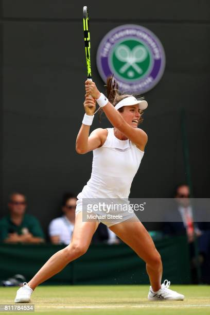 Johanna Konta of Great Britain plays a backhand during the Ladies Singles fourth round match against Caroline Garcia of France on day seven of the...