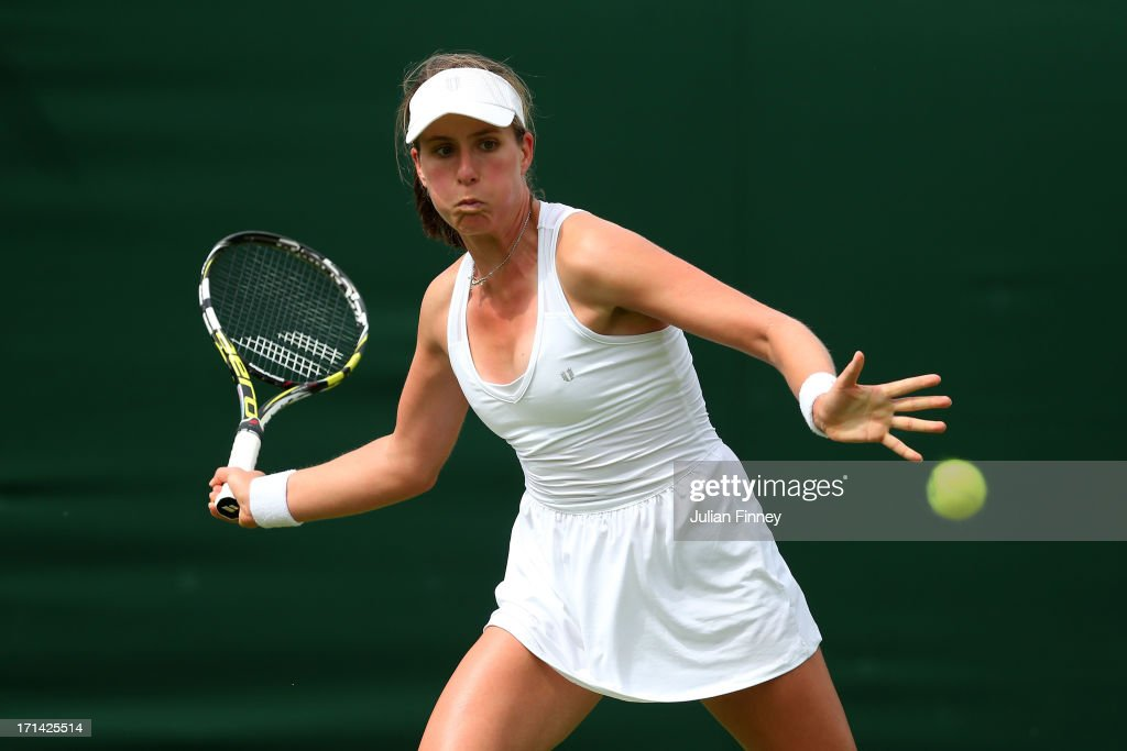Johanna Konta of Great Britain plays a forehand during her Ladies' Singles first round match against Jelena Jankovic of Serbia on day one of the Wimbledon Lawn Tennis Championships at the All England Lawn Tennis and Croquet Club on June 24, 2013 in London, England.