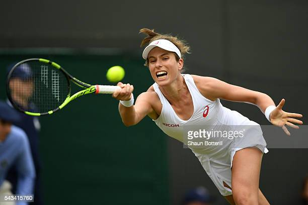 Johanna Konta of Great Britain plays a forehand during the Ladies Singles first round match against Monica Puig of Puerto Rico on day two of the...