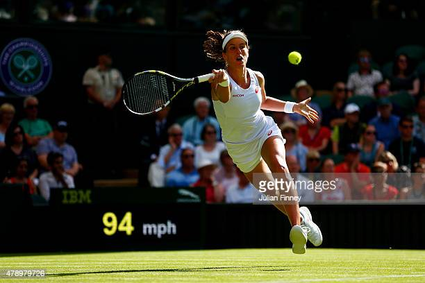 Johanna Konta of Great Britain plays a forehand in her Ladies's Singles first round match against Maria Sharapova of Russia during day one of the...