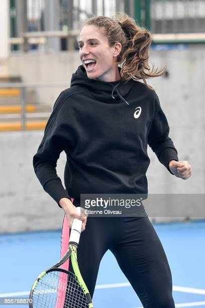 Johanna Konta of Great Britain plays tennis with kids during the event 'Tennis into Campus' during day 1 of the 2017 China Open at the China National...
