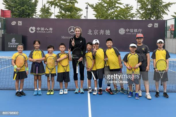 Johanna Konta of Great Britain poses for a picture with kids during the event 'Tennis into Campus' during day 1 of the 2017 China Open at the China...