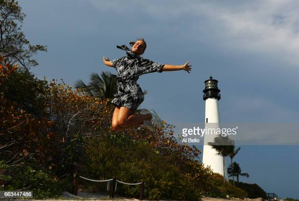 Johanna Konta of Great Britain poses in front of the Cape Florida Lighthouse after defeating Caroline Wozniacki of Denmark in the Women's Final on...