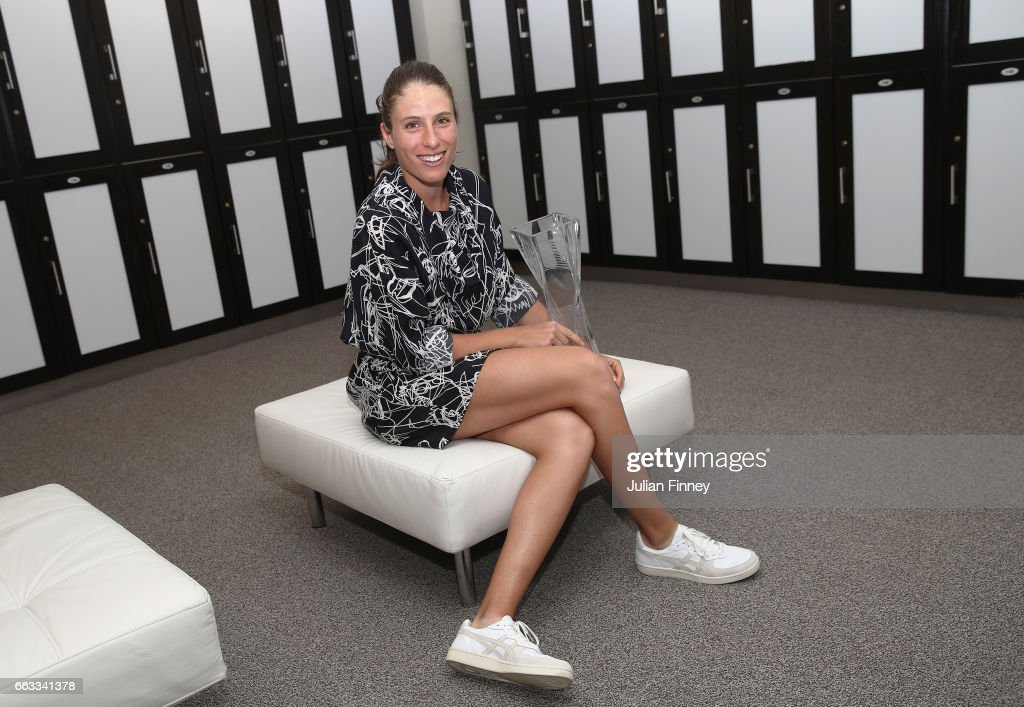 Johanna Konta of Great Britain poses with the trophy in the changing room after defeating Caroline Wozniacki of Denmark in the final at Crandon Park Tennis Center on April 1, 2017 in Key Biscayne, Florida.