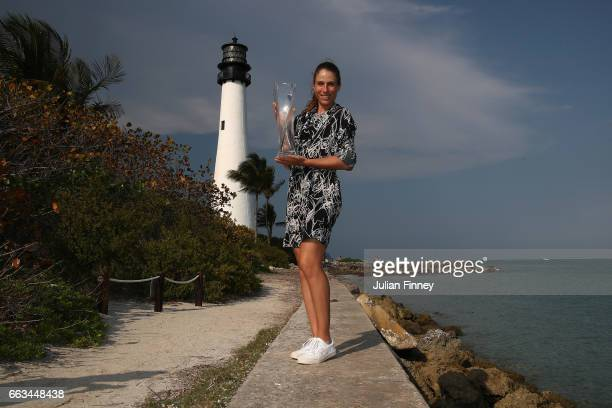 Johanna Konta of Great Britain poses with the trophy next to a lighthouse during a photo shoot after she defeated Caroline Wozniacki of Denmark in...