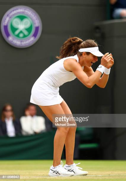Johanna Konta of Great Britain reacts as she celebrates victory after the Ladies Singles fourth round match against Caroline Garcia of France on day...