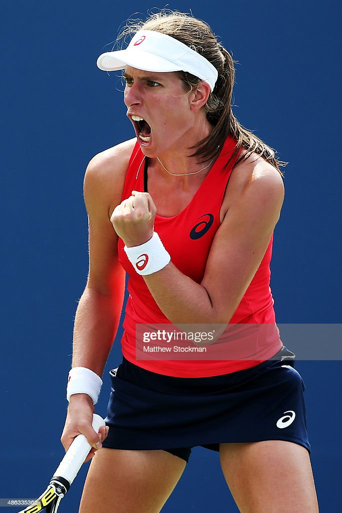 Johanna Konta of Great Britain reacts during her Women's Singles Second Round match against Garbine Muguruza of Spain on Day Four of the 2015 US Open...