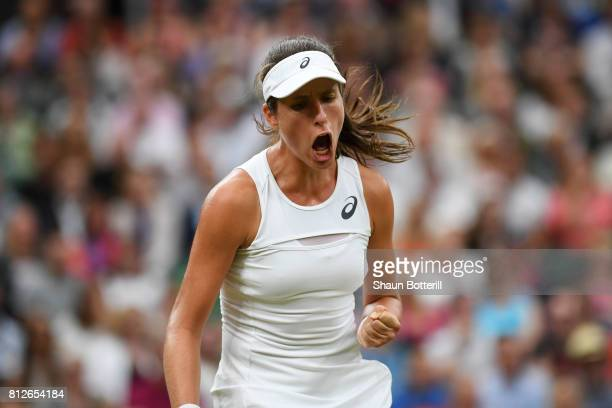 Johanna Konta of Great Britain reacts during the Ladies Singles quarter final match against Simona Halep of Romania on day eight of the Wimbledon...