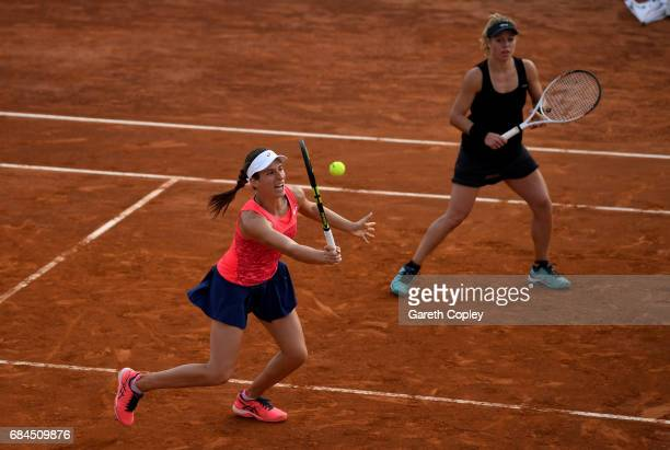 Johanna Konta of Great Britain returns a long side her partner Laura Siegemund of Germany during their match against Sara Errani and Martina Trevisan...