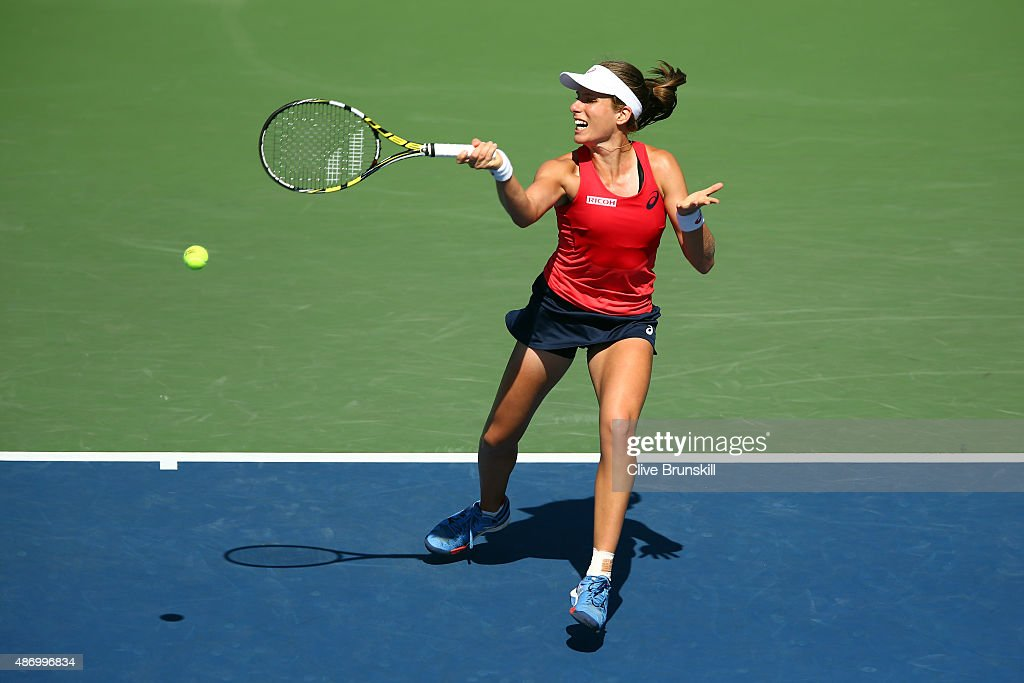 Johanna Konta of Great Britain returns a shot against Andrea Petkovic of Germany during their Women's Singles Third Round match on Day Six of the...