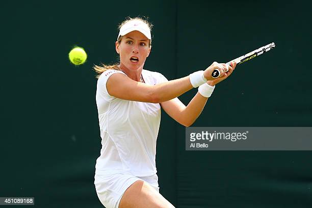 Johanna Konta of Great Britain returns a shot during her Ladies' Singles first round match against Shuai Peng of China on day one of the Wimbledon...