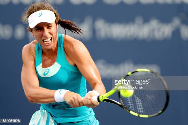 Johanna Konta of Great Britain returns a shot to Dominika Cibulkova of Slovakia during day 6 of the Western Southern Open at the Lindner Family...