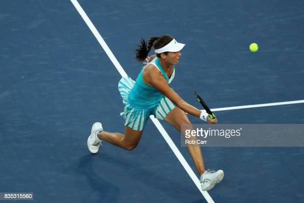Johanna Konta of Great Britain returns a shot to Simona Halep of Romania during Day 7 of the Western and Southern Open at the Linder Family Tennis...